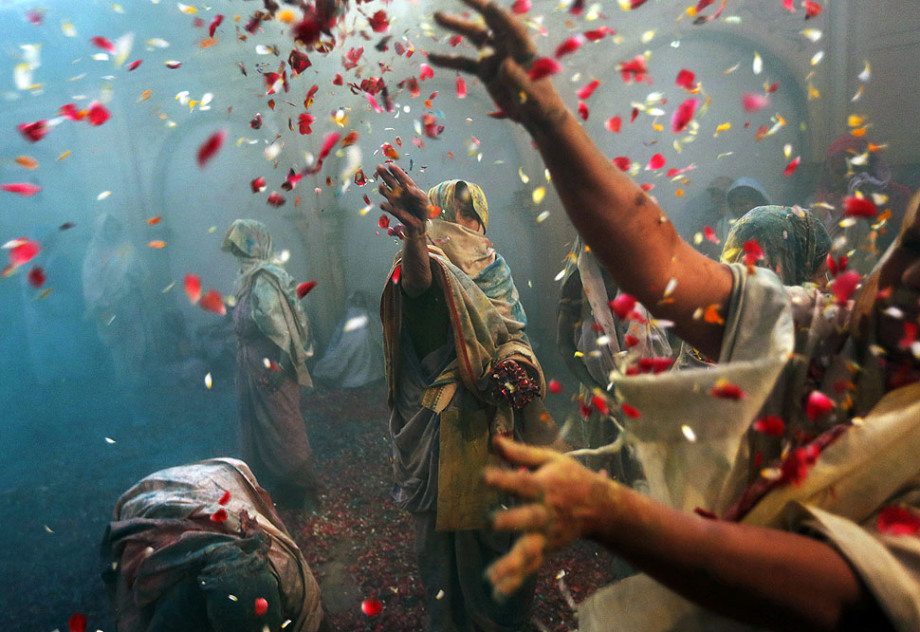 Indian Hindu widows throw flowers as part of Holi celebrations organized by the NGO Sulabh at the Meera Sahbhagini Ashram in Vrindavan. The widows, many of whom at times have lived desperate lives in the streets of the temple town, celebrated the festival for the first time at the century old ashram.